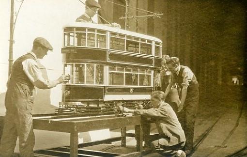 Giants building a tram