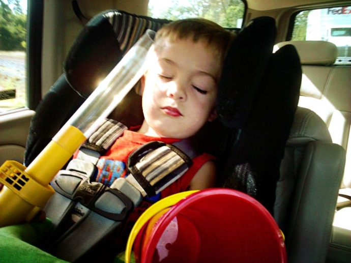 napping child with bug sucker and a bucket
