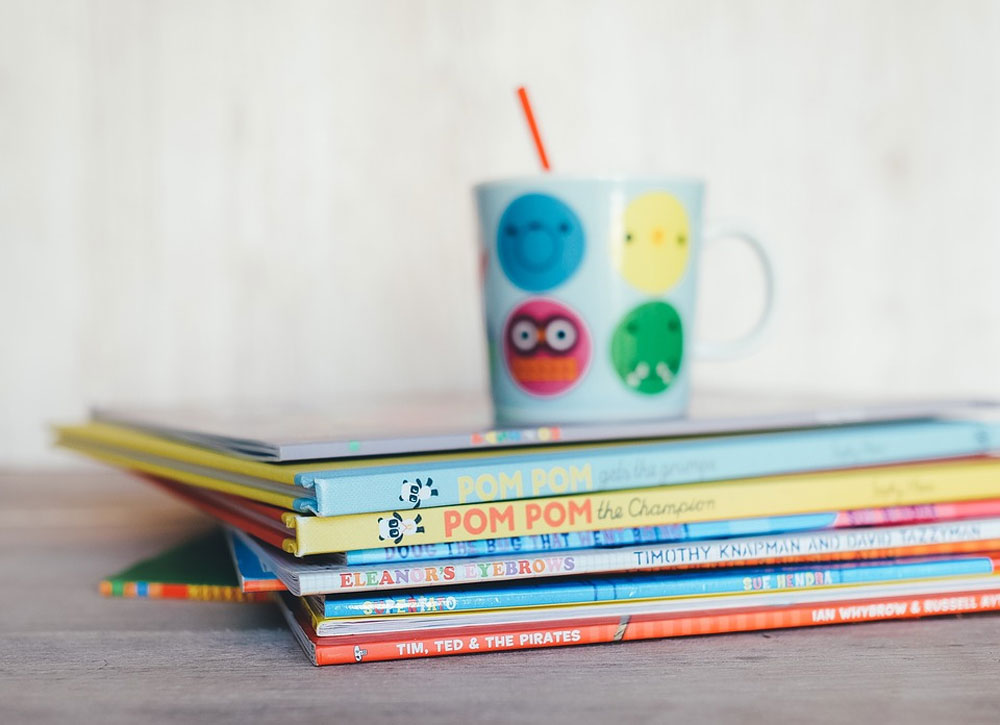 Stack of colorful children's books.