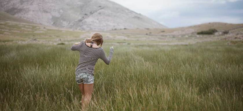 Girl walking through a field homeschool