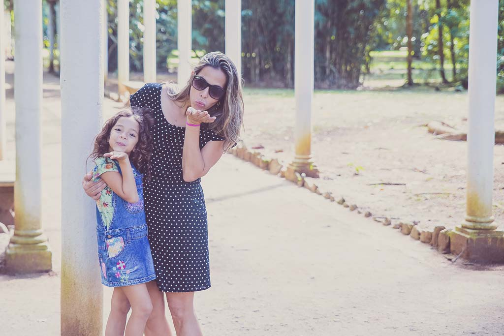 Mom and daughter blowing kisses