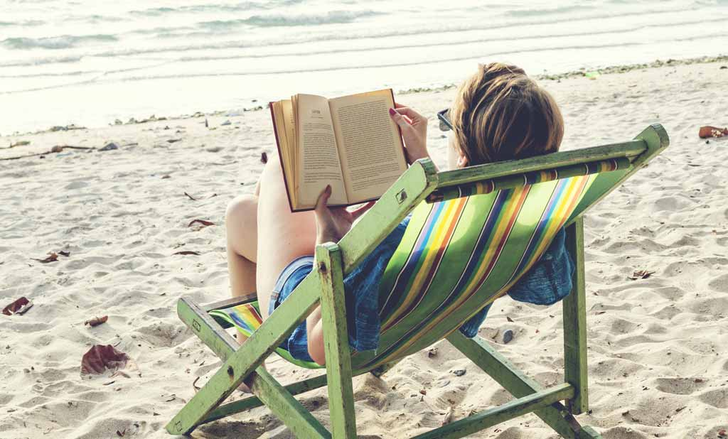 Woman Summer Reading on the Beach