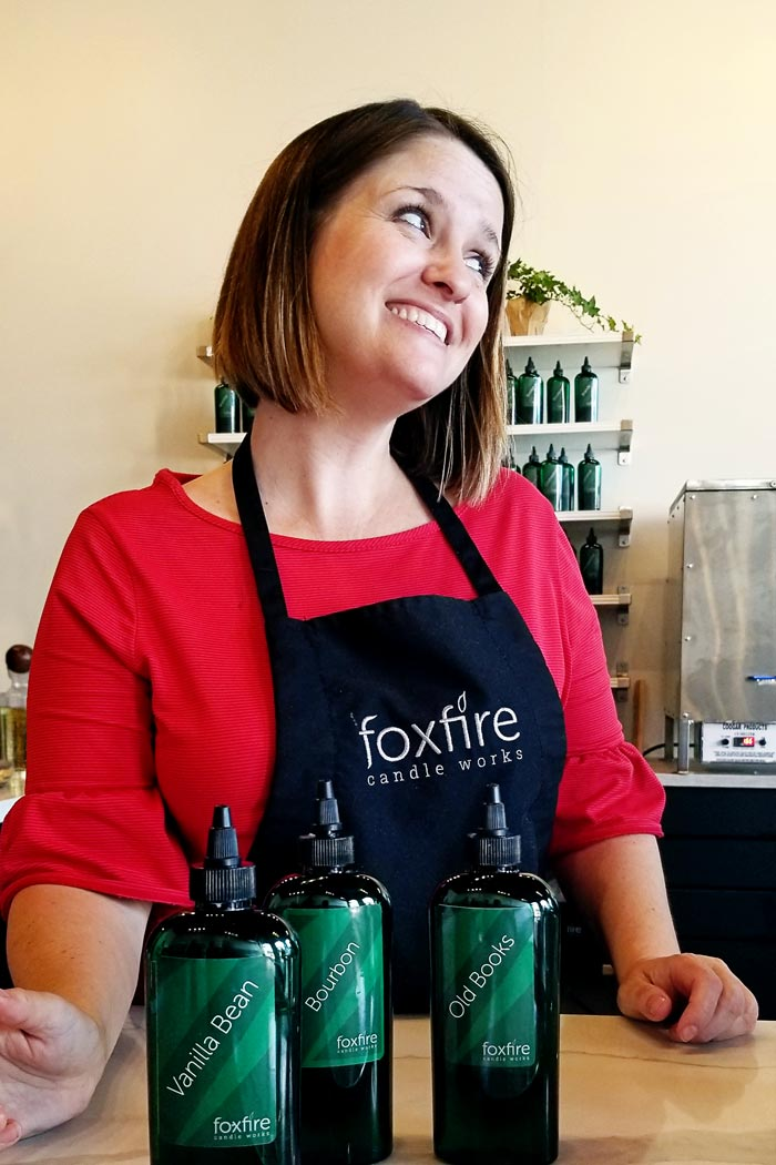 Woman in a red dress wearing a foxfire apron