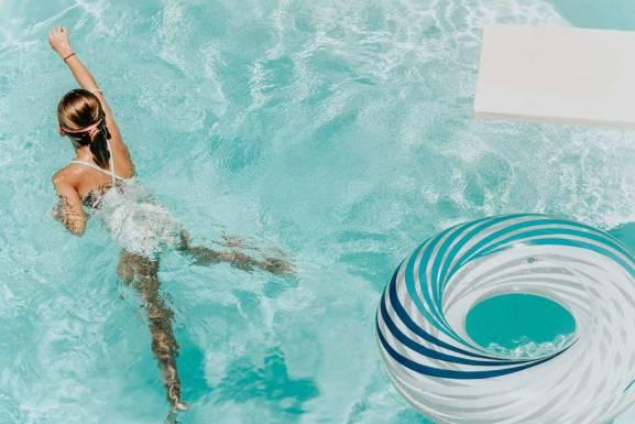 girl swimming tube diving board