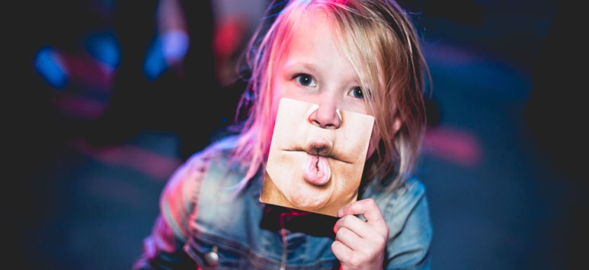 blonde girl with puzzle piece of lips held over her own face