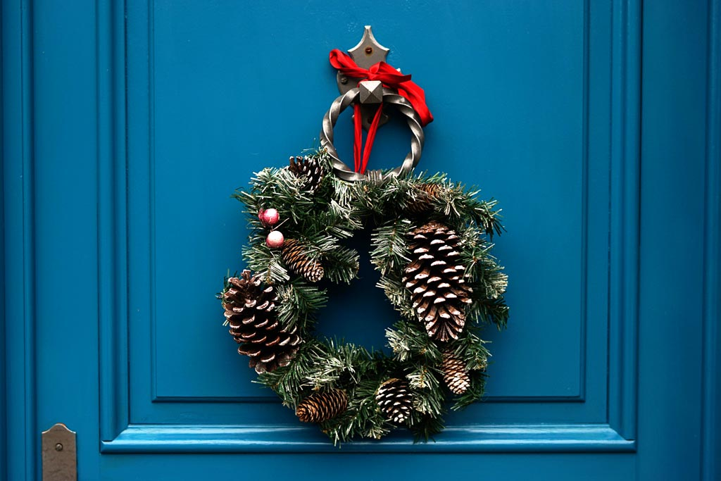 Blue door with a Christmas wreath for sensory friendly fun