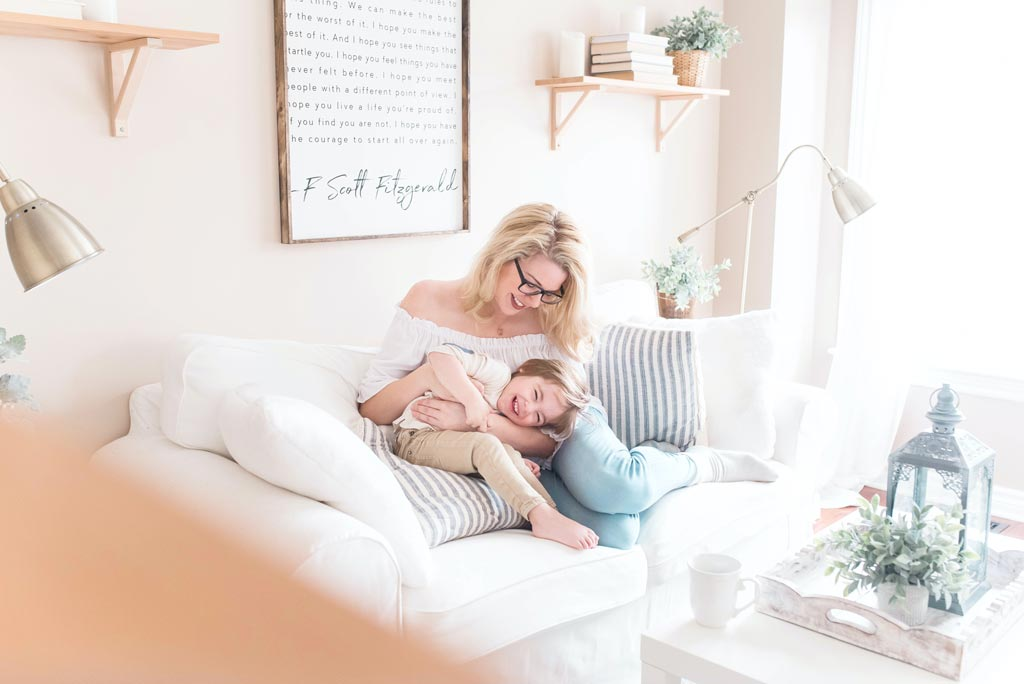back to school Houston 2021 - Mom and daughter hugging on white couch
