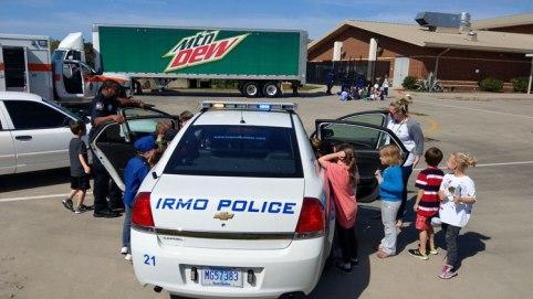 Kids Looking at Police Car