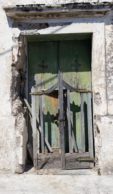 Old green door in Positano