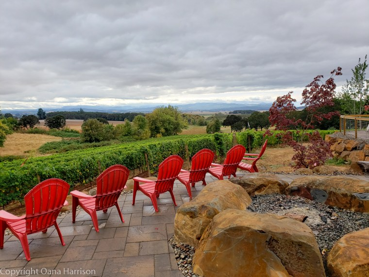 Eola Hills Legacy Winery Salem Oregon red chairs overlooking the vines