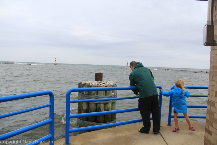 Holland-State-Park-Michigan-dad-and-daughter-by-pier