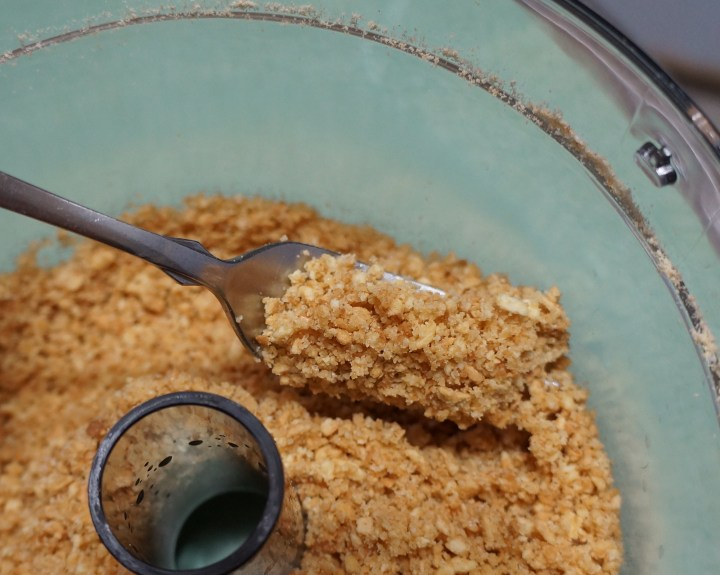 Buttery sweetened cookie crumbs - they should look moistened by the butter - they should not look wet.