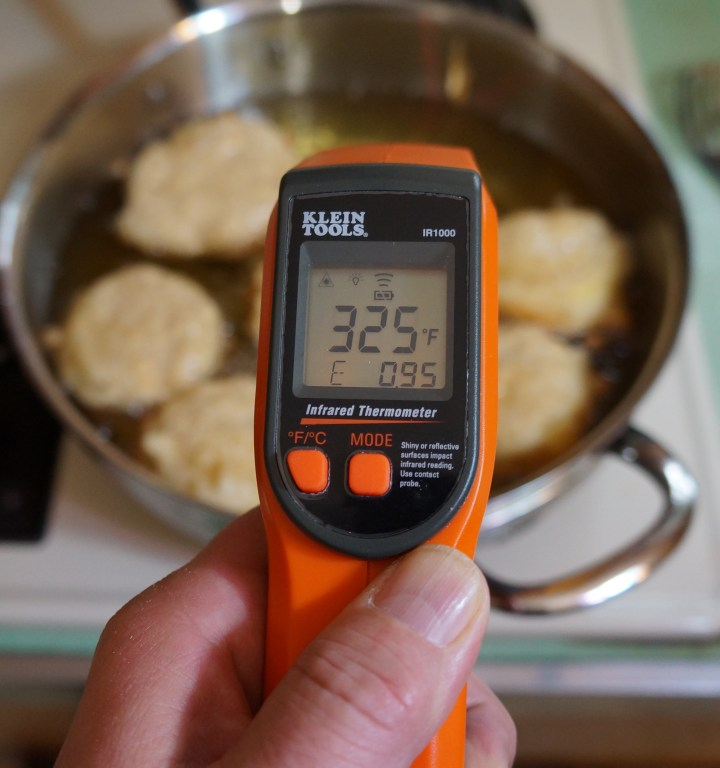 Also be aware that the temperature of the oil will drop with the addition of the fritters.  Adjust your stove as necessary to insure that the temperature climbs back up to the target temperature of about 350° F.