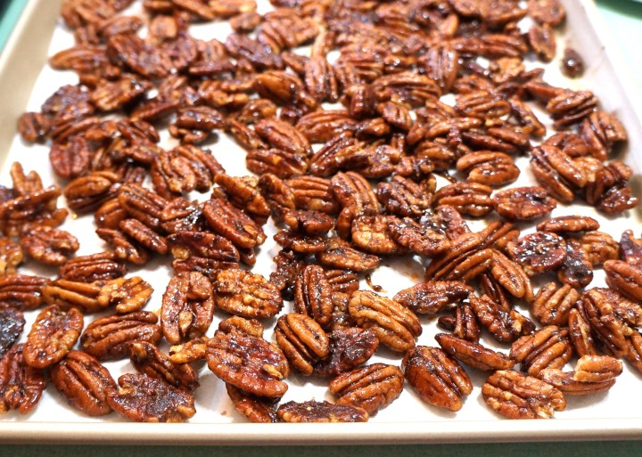 Pour the glazed pecans onto your prepared sheet pan and separate the nuts so they won't clump.  Work quickly.