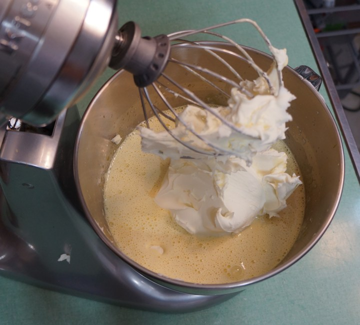 Then add the mascarpone cheese, all at once, and whisk the mixture until it is uniform and smooth - another 2 or 3 minutes.