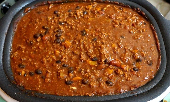 Once the ingredients are hot enough to bubble, add the spices mix and stir to distribute uniformly.  Let the chili continue to slow cook for another hour (or two).