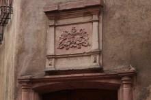 Small plaque adorning a doorway