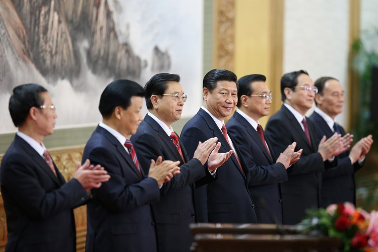 BEIJING, CHINA - NOVEMBER 15:  (L-R) Zhang Gaoli, Liu Yunshan, Zhang Dejiang, Xi Jinping, Li Keqiang, Yu Zhengsheng and Wang Qishan greet the media at the Great Hall of the People on November 15, 2012 in Beijing, China. China's ruling Communist Party today revealed the new Politburo Standing Committee after its 18th congress.  (Photo by Feng Li/Getty Images)