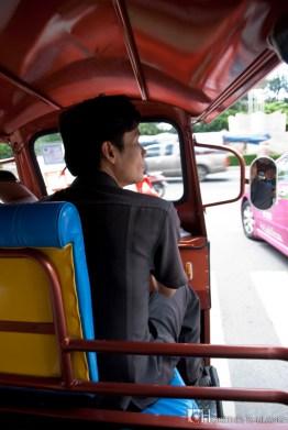 Riding the famous tuk-tuk at Bangkok.