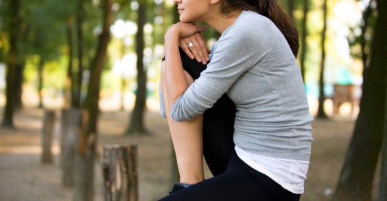 Young Woman Thinking in Woods