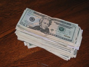 A pile of $20 bills on a table, similar to the Dulles airport currency seizure case mentioned in this article
