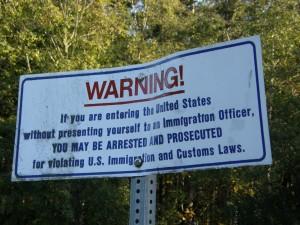 Warning Border Crossing Sign
