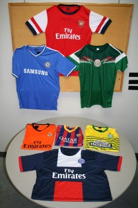 A few of the counterfeit soccer jersey seizures displayed.