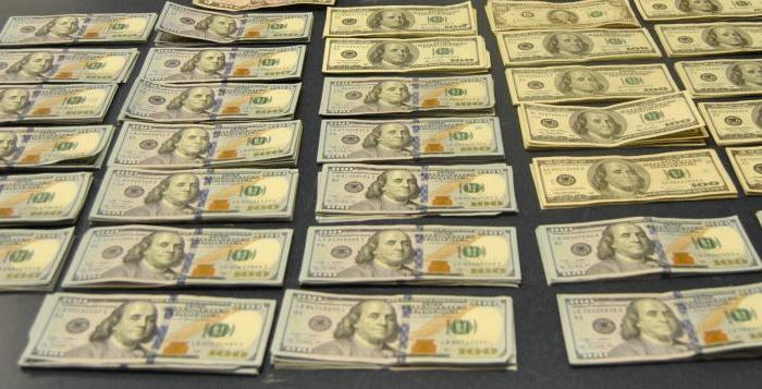 Stacks of $100 bills in row after a customs currency seizure in a story about reporting currency in the Caribbean.