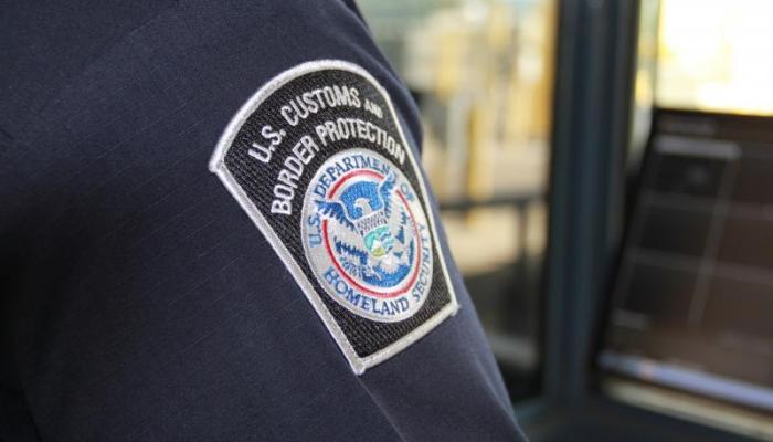 U.S. Customs & Border Protection Officer's uniform, featuring the seal of the agency.