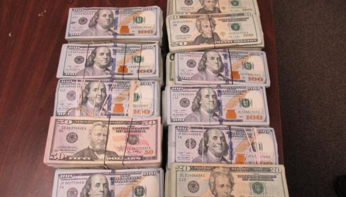 Stacks of bills totaling $163,130 in unreported currency seized by CBP officers at Hidalgo International Bridge