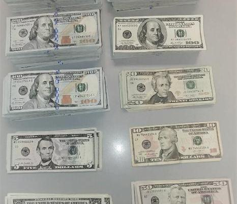 Stacks of cash that Houston CBP seized from travelers leaving the country