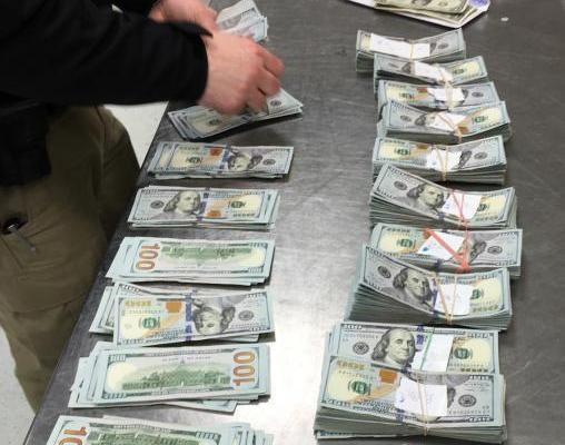 CBP Counting Seized Money on Steel Table