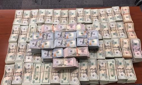 $1 million dollars stacked on table seized by U.S. Customs & Border Protection