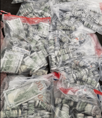 Over $500,000 seized by Customs storedi n clear evidence bags