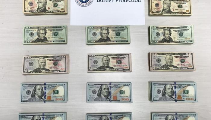 Piles of money seized by Philadelphia CBP