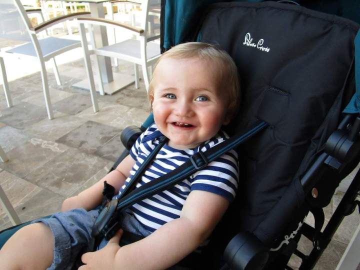 Jake happy in his Silver Cross Pop stroller