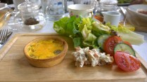 Pepper and caramalized onion quiche and salad.
