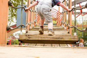 Child On Playground For Baptism 973x649
