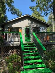 Pine Cottage offers a more private front entry way, with a fireplace steps from your deck and a different view of the waterfront than the other cottages!