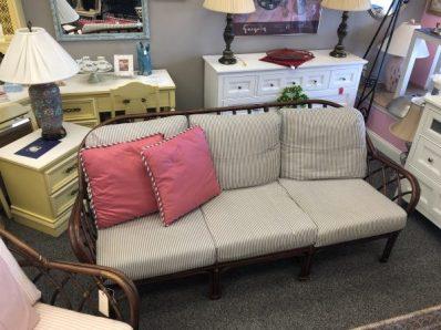 Rattan sofa with cushions $195