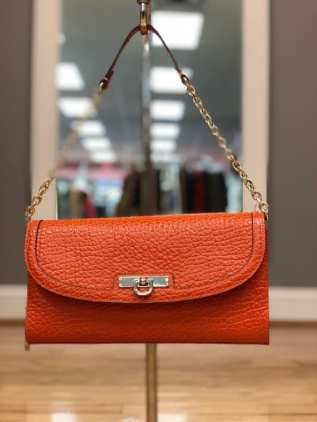 $49 Orange textured DKNY purse with chain strap