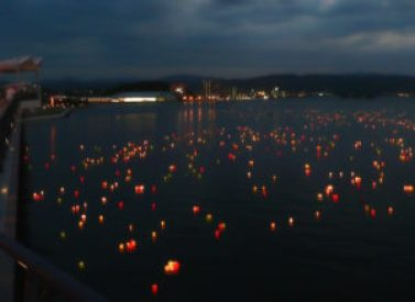 At the end of the Obon festival in Matsue, Japan, paper lanterns are place on Lake Shinji, symbolizing the departure of ancestor spirits to the other world.