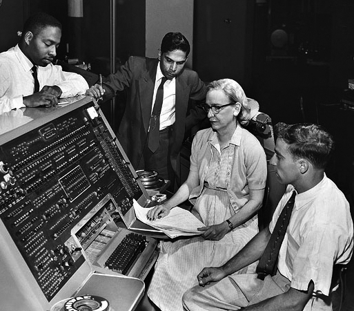SI Neg. 83-14878. Date: na. Grace Murray Hopper at the UNIVAC keyboard, c. 1960. Grace Brewster Murray: American mathematician and rear admiral in the U.S. Navy who was a pioneer in developing computer technology, helping to devise UNIVAC I. the first commercial electronic computer, and naval applications for COBOL (common-business-oriented language). Credit: Unknown (Smithsonian Institution)