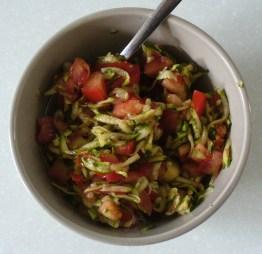 Raw grated zucchini, tomato and balsamic salad