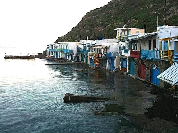 Colourful small houses in front of the sea, called Syrmata