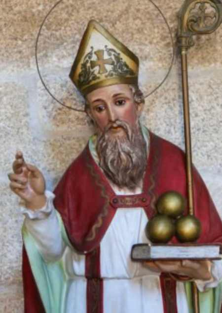 Statue of Saint Nicholas of Bari in the church of San Francisco in the historic town Betanzos, Galicia, Spain. Saint Nicholas is holding three balls of gold, that represent the legend of the dowry he gave to three unmarried girls.
