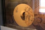 Votive shield form bothros at Tiryns in Nafplio museum