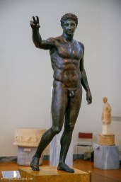 Bronze statue of standing youth