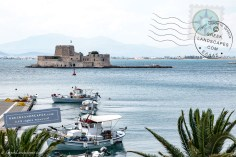 Bourtzi and fishing boats in Nafplio port
