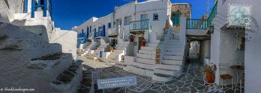 Narrow street with white homes and staircases